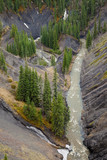 Aerial view of a mountain creek in a deep canyon, Rocky Mountains, Canada - 233693090
