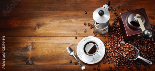 Foto Murales Moka with espresso cup, coffee beans, scoop and grinder. Top view space for text