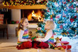 Quadro Child at Christmas tree. Kids at fireplace on Xmas