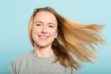 woman with hair flying in the wind. haircare products and beauty concept.