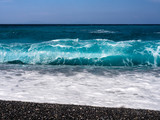 Beautiful foam waves on a sunny day in the Aegean Sea on the island of Evia in Greece