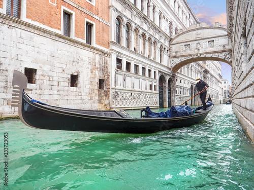 fototapeta na ścianę Bridge of sighs. Traditional Venetian transport. Gondola floating along the canal