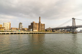 Domino Park in Brooklyn, Williamsburg, Old sugar factory and Williamsburg Bridge in New York