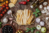 Stylish composition of italian ingredients and food on the vintage wooden table. Culinary backgrounds. Top view.