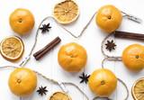 Ripe mandarine, tangerine mandarine orange on wooden white table. Mandarines with cinnamon sticks and anise stars. Orange citrus fruits. Christmas.
