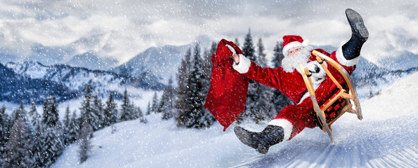 late Santa claus in a hurry with sleigh traditional red white costume and big gift bag © stockphoto-graf