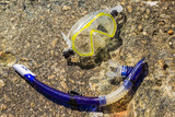snorkeling amateur mask equipment on stone summer vacation holidays concept background shot