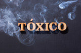 Toxic word in wooden letters - Black background - 233737497