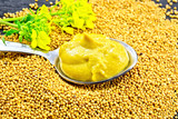Sauce mustard in spoon with flower on seeds - 233742043