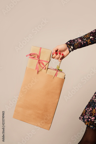 woman with a shopping bag full of gifts.