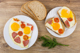 Sandwiches with fried egg, sausage, tomatoes, bread, dill on table - 233753642