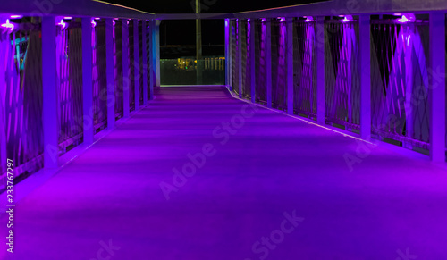 neon purple lighted bridge walking road modern architecture in scheveningen a popular city in the netherlands - 233767297