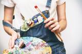 girl painter holds a brush - 233774604