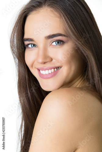 Leinwanddruck Bild Gorgeous girl, studio shot isolated on white background. Beautiful young woman's portrait. Happy woman with beautiful smile and long hair.