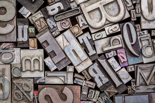Leinwandbild Motiv old letterpress metal type printing blocks