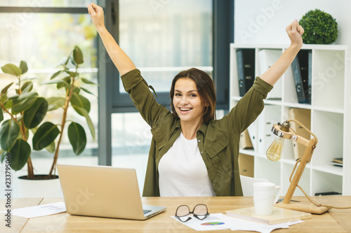 fototapeta na ścianę I am a winner! Portrait of young cheerful business woman in smart casual wear having fun and smiling.