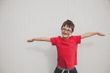 Happy Young Boy With Red T Shirt