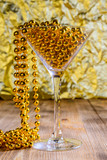 bright martini glass on a golden festive background - 233807805