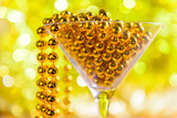 bright martini glass on a golden festive background - 233807826