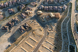 Aerial view of new streets, homes and graded lots near Los Angeles, California. - 233841096