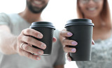 close up.couple in love with cups of coffee