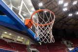 Basketball hoop in a professional basketball arena. - 233869204