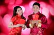 Leinwandbild Motiv Happy couple holds envelope in the studio
