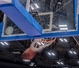 Basketball hoop in a professional basketball arena. - 233869636