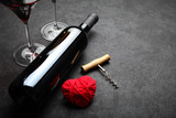 Bottle of wine and a red heart Love and romance. - 233874645