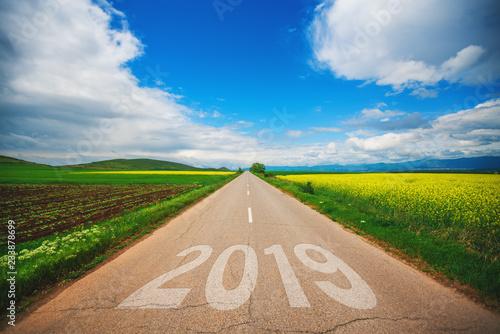 Leinwandbild Motiv new year 2019.Driving on an empty asphalt road at beautiful sunny day.