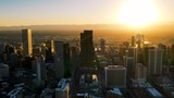 Timelapse - Drone footage of the city of Denver Colorado at sunset.  Rocky Mountains on the horizon. - 233884863