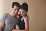 Young couple smiling - 233891098