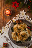 Traditional dumplings with cabbage and mushrooms. Christmas decoration.