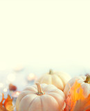 Thanksgiving background. Holiday scene. Wooden table, decorated with pumpkins, autumn leaves and candles. Vertical image - 233928207