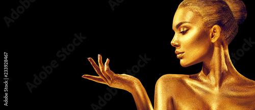 Leinwanddruck Bild Golden woman. Beauty fashion model girl with golden skin, makeup, hair and jewellery on black background. Fashion art portrait