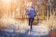 Leinwandbild Motiv Young girl running in the park in early winter