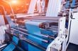 Leinwandbild Motiv Modern automated production line in factory. Plastic bag manufacturing process
