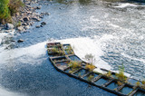 Concrete construction protruding from the surface of the water covered with foam - 233942843