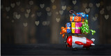 colorful christmas gift boxes on the top of toy plane - 233947284