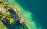 Aerial view on the lake and forest. Natural landscape from drone. Aerial landscape from air in the Switzerland - 233957616