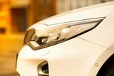 Headlights and hood of sport brown car