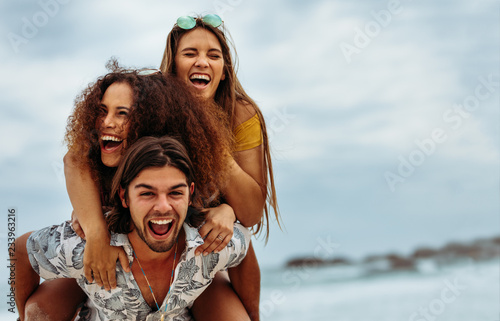 fototapeta na ścianę Group of friends enjoying themselves at the beach