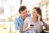 Joyful couple listening to online music together