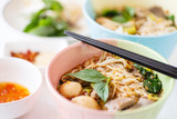 Spicy rice noodles soup in a bowl with chopsticks, Thai food - 233996402