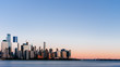 Skyline of downtown Manhattan over Hudson River under blue sky, at sunset, in New York City, USA