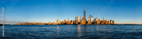 Panorama of skyline of Manhattan over Hudson River under blue sky, in New York City, USA - 233997461
