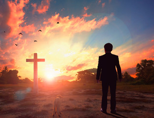 Thanksgiving concept: a businessman standing in front of the cross