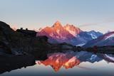 Colourful sunset on Lac Blanc lake in France Alps. Monte Bianco mountain range on background. Vallon de Berard Nature Preserve, Chamonix, Graian Alps. Landscape photography - 234042649