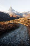 Picturesque view of Matterhorn Cervino peak, dirt road and Stellisee lake in Swiss Alps. Zermatt resort location, Switzerland. Landscape photography - 234043056
