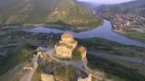Aerial drone view of Mtskheta, Georgia with Svetitskhoveli Cathedral - 234060207
